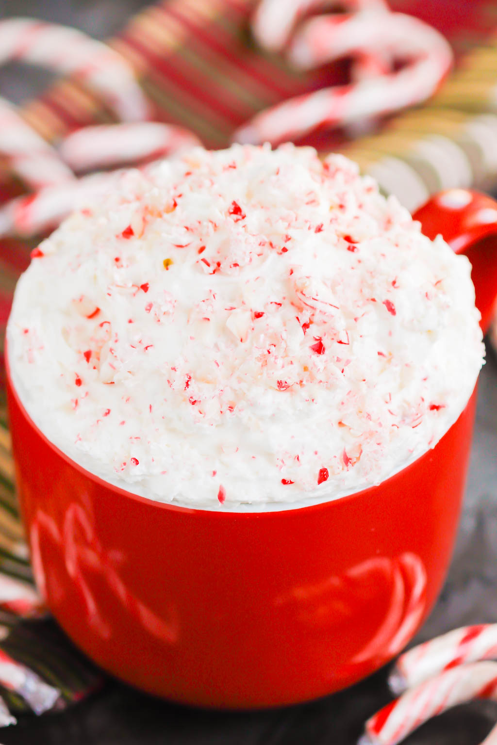 You're going to fall in love with how easy and delicious this Peppermint Cheesecake Dip recipe is to make. It's a bright and refreshing dessert option for your holiday table. This treat mixes up in minutes and will be a hit with everyone! #peppermint #peppermintdip #peppermintcheesecake #peppermintcheesecakedip #candycanedip #dessert #christmasdessert #holidaydessert