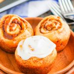 These Easy Pumpkin Cinnamon Rolls are a fun twist on the classic kind and ready in just 30 minutes. Filled with sweet pumpkin, cozy spices and topped with the most delicious cinnamon cream cheese frosting, these rolls are perfect for breakfast or dessert! #cinnamonrolls #cinnamonrollrecipe #pumpkin #pumpkincinnamonrolls #pumpkinbreakfast #pumpkindessert #dessertrecipes #breakfastrecipes #fallrecipes #breakfast #dessert
