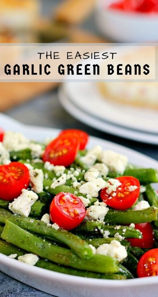 Roasted Garlic Green Beans arefilled with fresh beans, ripe tomatoes and feta cheese, combined with a light garlic and lemon dressing! #greenbeans #greenbeanrecipe #roastedgreenbeans #vegetables #roastedvegetables #sidedish #easysidedish
