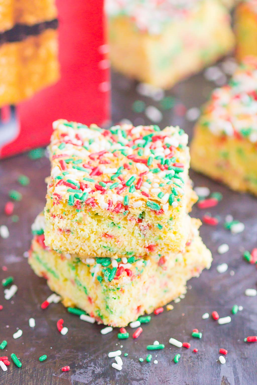 Holiday Cake Mix Bars make a simple, one bowl treat that's ready in no time. With just a few ingredients, these bars bake up soft, chewy, and all-around delicious! #cake #cakebars #cakerecipe #cakebarrecipe #easycakerecipe #holidaycake #holidaydessert #christmascake #christmasdessert #dessert