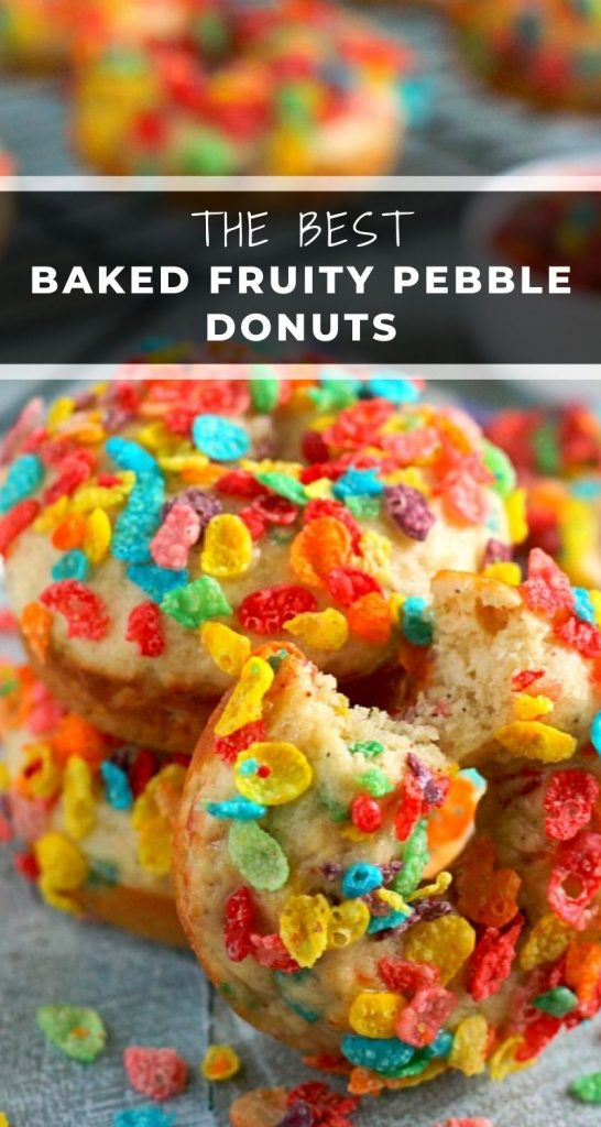 These Baked Fruity Pebble Donuts feature a fluffy vanilla batter, packed with sweet Fruity Pebbles. The donuts are baked and then topped with a rich, vanilla glaze. Healthier than the fried kind and so delicious, these treats will bring out the kid inside of you! #donuts #bakeddonuts #donutrecipe #fruitypebbledonuts #fruitypebblerecipe #breakfast #dessert
