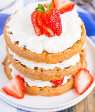 Strawberry Shortcake Waffles make a deliciously sweet and easy breakfast. Made with fresh strawberries, and whipped cream sweetened with honey, this dish is the perfect way to start your day!