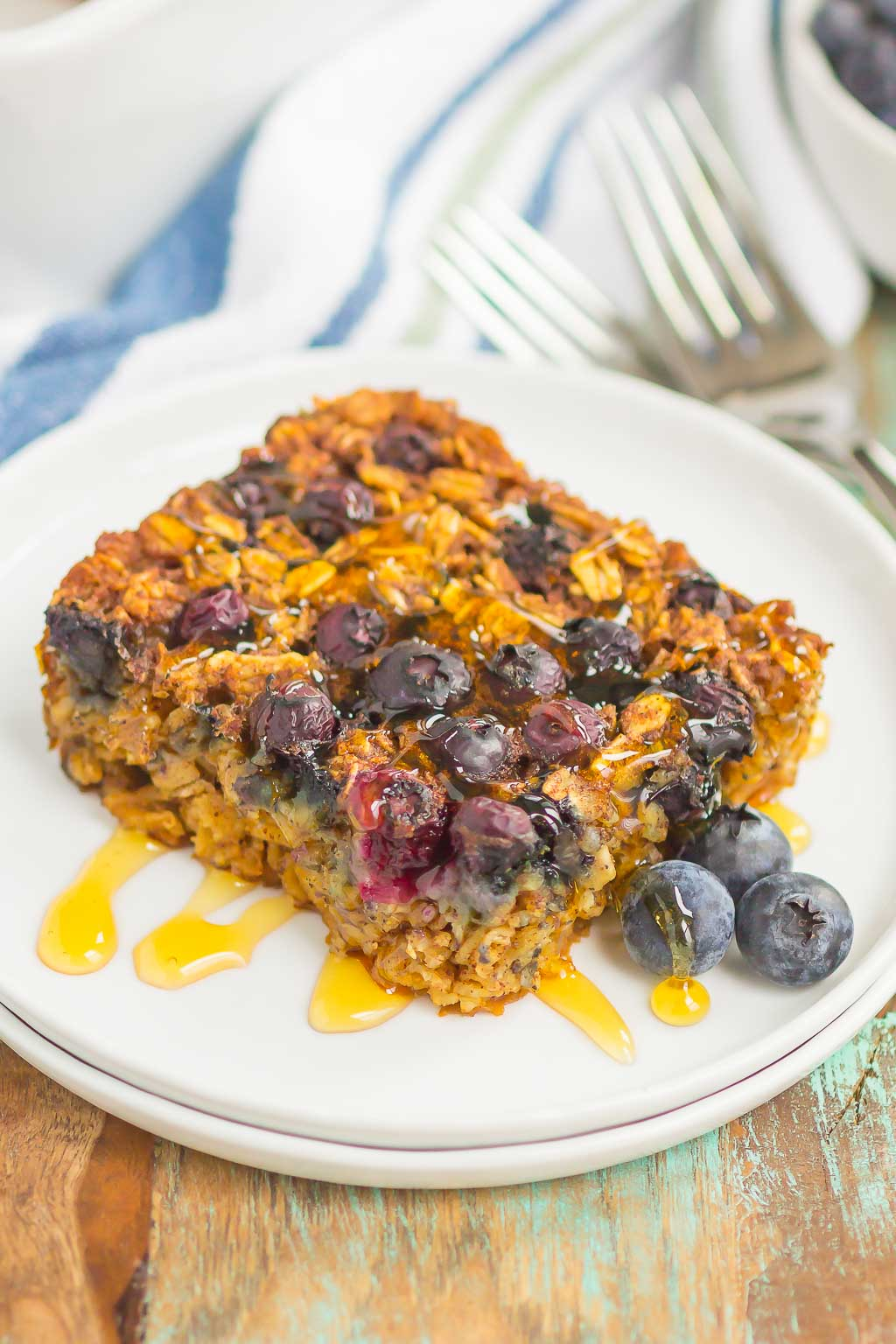 Blueberry Baked Oatmeal is an easy, make-ahead dish that's perfect for busy mornings. Tangy blueberries and hearty oats are sweetened with just the right amount of cozy spices. Serve this baked oatmeal with a drizzle of honey or maple syrup for a hearty breakfast!