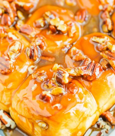 Caramel Sticky Buns are soft, sweet, and ready in just 30 minutes. Sweet rolls are topped with a rich caramel sauce, chopped pecans, and then baked until golden. Perfect for breakfast or dessert! #stickybuns #sweetrolls #caramelstickybuns #caramelrolls #breakfast #dessert