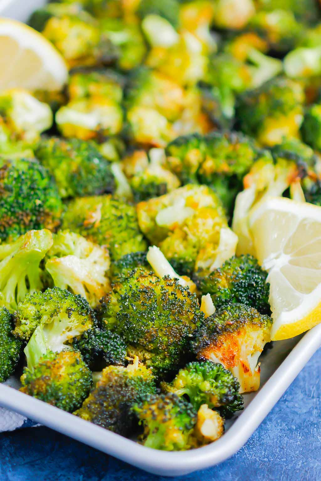Roasted Garlic Lemon Broccoli is an easy side dish that's ready in less than 30 minutes. With just four ingredients, this simple veggie is tender, yet slightly crispy and all-around delicious!