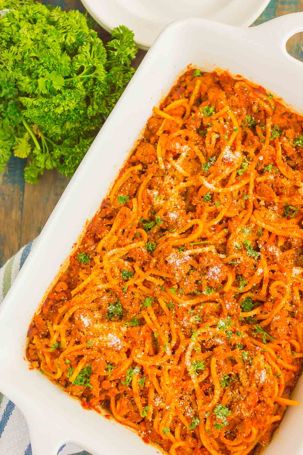 Easy Baked Spaghetti is a simple meal that's perfect for busy weeknights. With no need to boil the spaghetti and an easy meat sauce that's full of flavor, this hearty dish is the perfect comfort food!