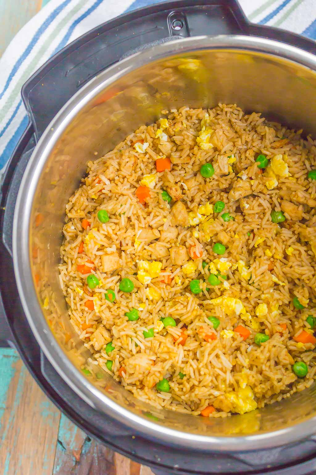Instant Pot Chicken Fried Rice is a simple, one pot recipe that's ready in no time. With just a few ingredients, this dish is perfect for meal prepping, lunch, or dinner!