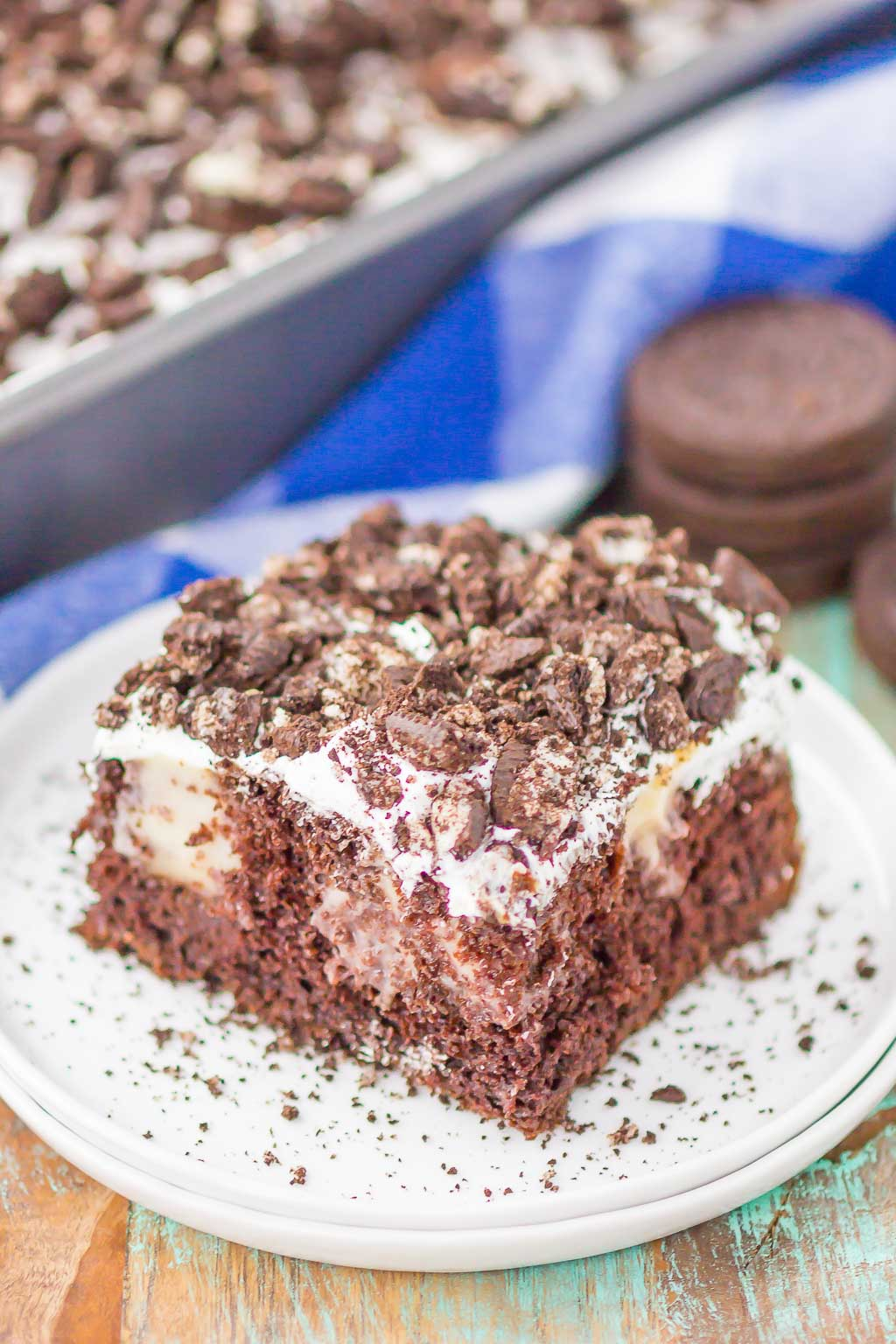 Oreo Pudding Poke Cake is chocolatey, fluffy, and simple to make. A fudgy cake is loaded with white chocolate pudding and studded with a creamy whipped topping and lots of Oreo cookies. The easiest, most delicious cake!