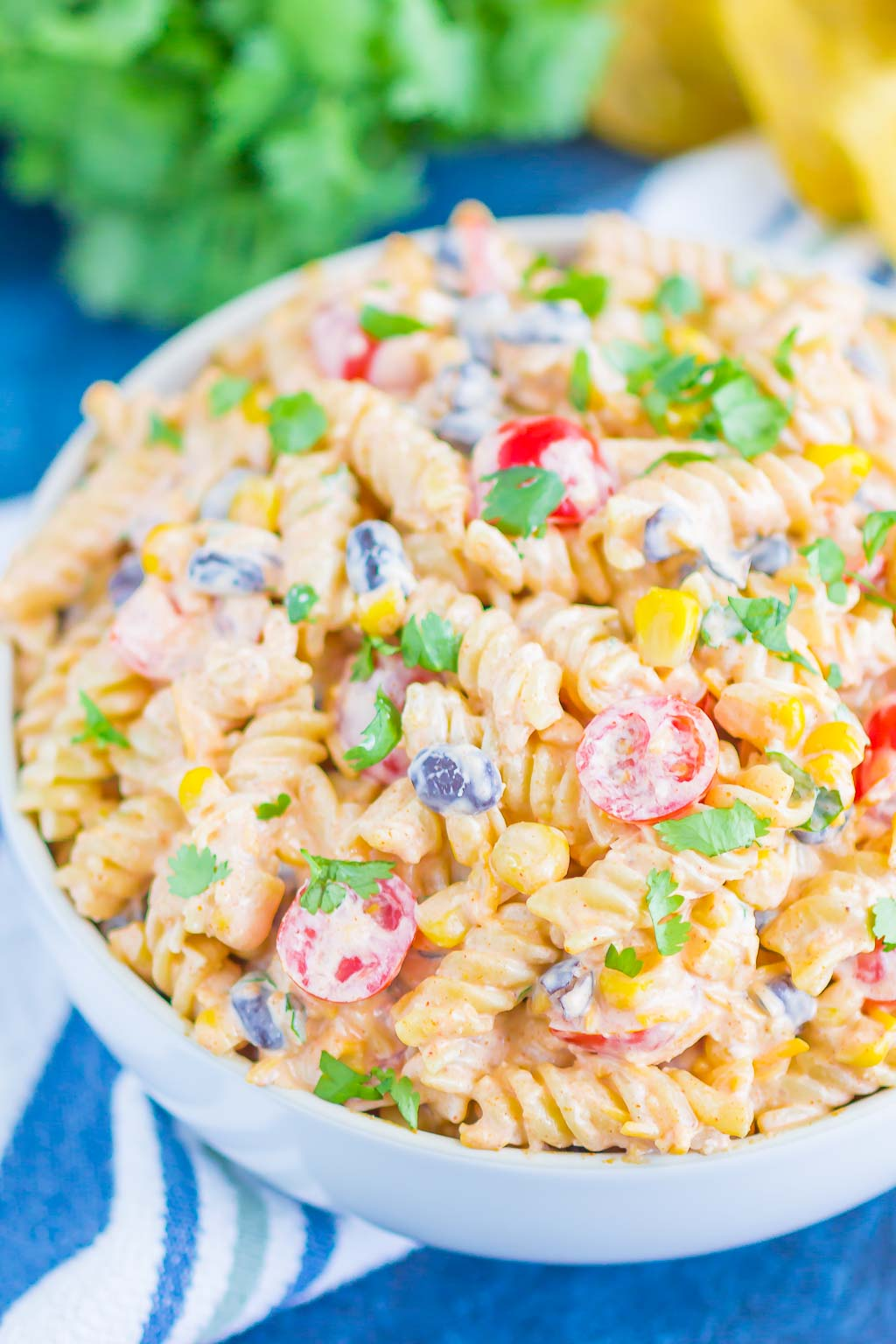 Taco Pasta Salad is loaded with Mexican flavors and ready in no time. With a creamy, zesty dressing and all of your favorite toppings, this easy pasta salad is perfect for your next party!