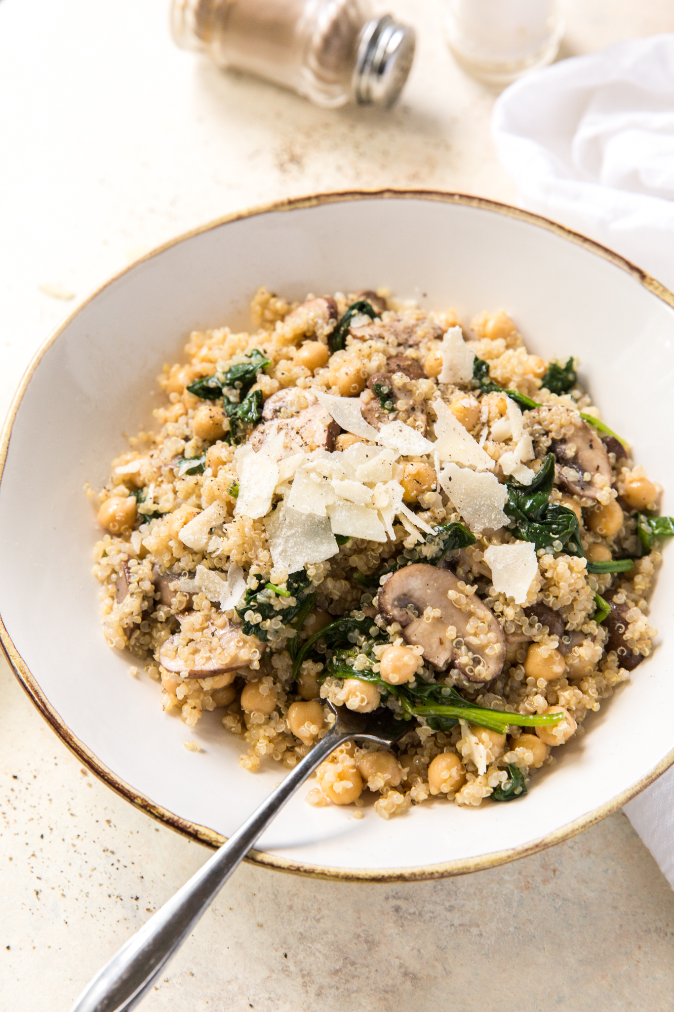 a healthy quinoa bowl topped with parmesan